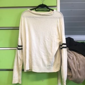 Cream sweater with black stripes on sleeve